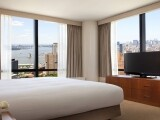 King Bedroom Deluxe Suite- (c) 2015 Hilton Hotels & Resorts